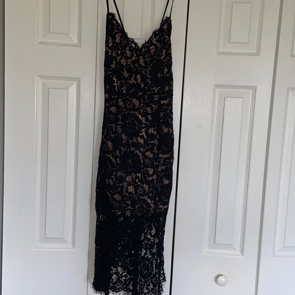 lace black dress worn to a wedding.
